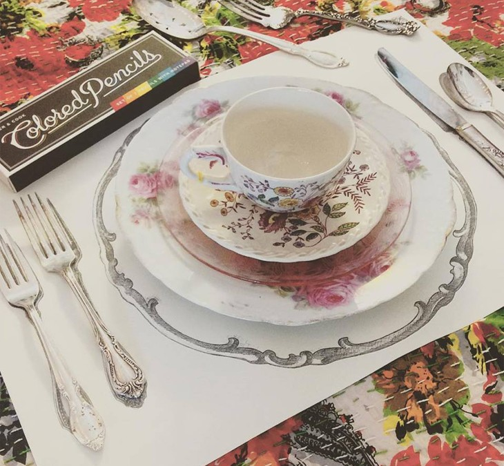 A perfect setting!  We just got a bunch of pretty new silver pieces  and they go great with these fun paper and colorable placemats.