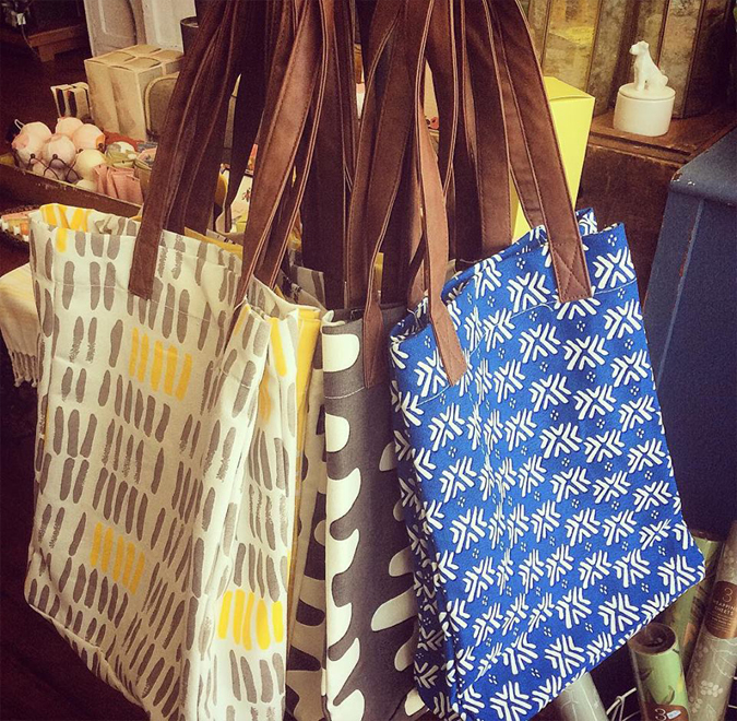 We just received a new shipment  of these fabulous canvas market bags in several new colors!  Great for the farmer's market!  We also have new pouches, too!