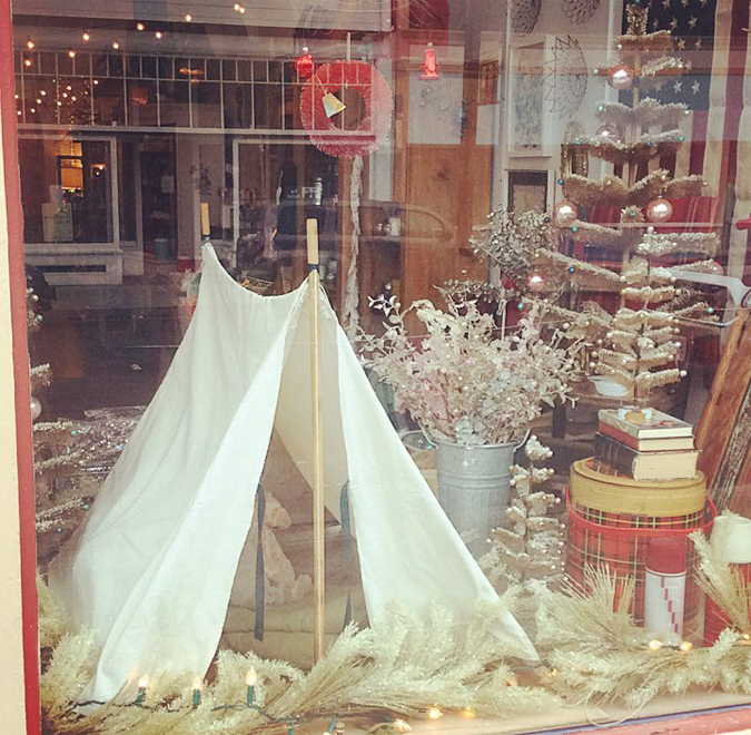 Happy little holiday camping window!!  Make sure to stop by tomorrow for first Friday!  We'll have hot cider and are all stocked on holiday decor and candles!!