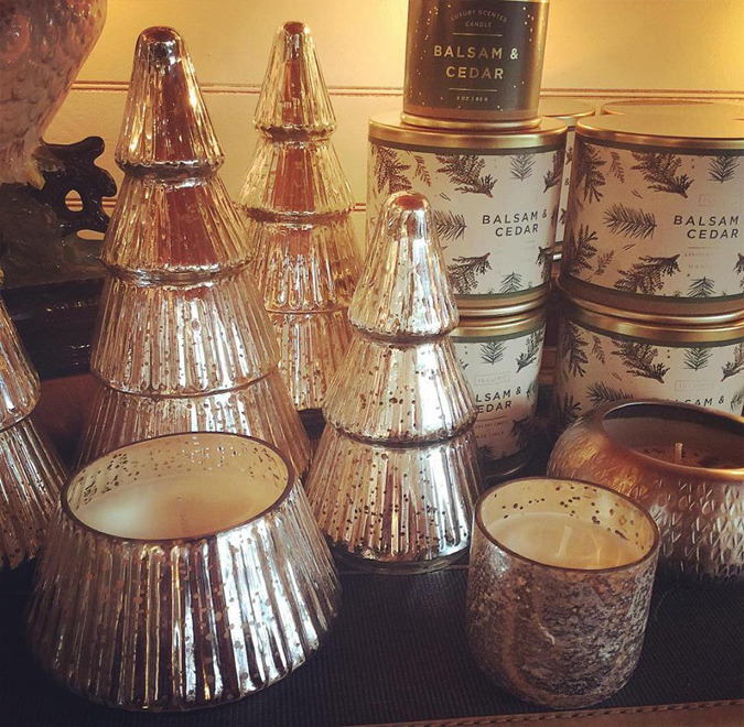 Christmas candles are here! 😍🎄❤️  So many shapes and sizes and our three favorite scents for the holidays:  Balsam & Cedar, Winter White, and Woodfire.  These glass tree are new this year -and make awesome containers when you're done!
