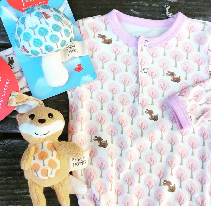 Lots of great new baby gifts are here!  We love this tree pattern which is available in toys and baby gowns  — so soft and organic cotton!